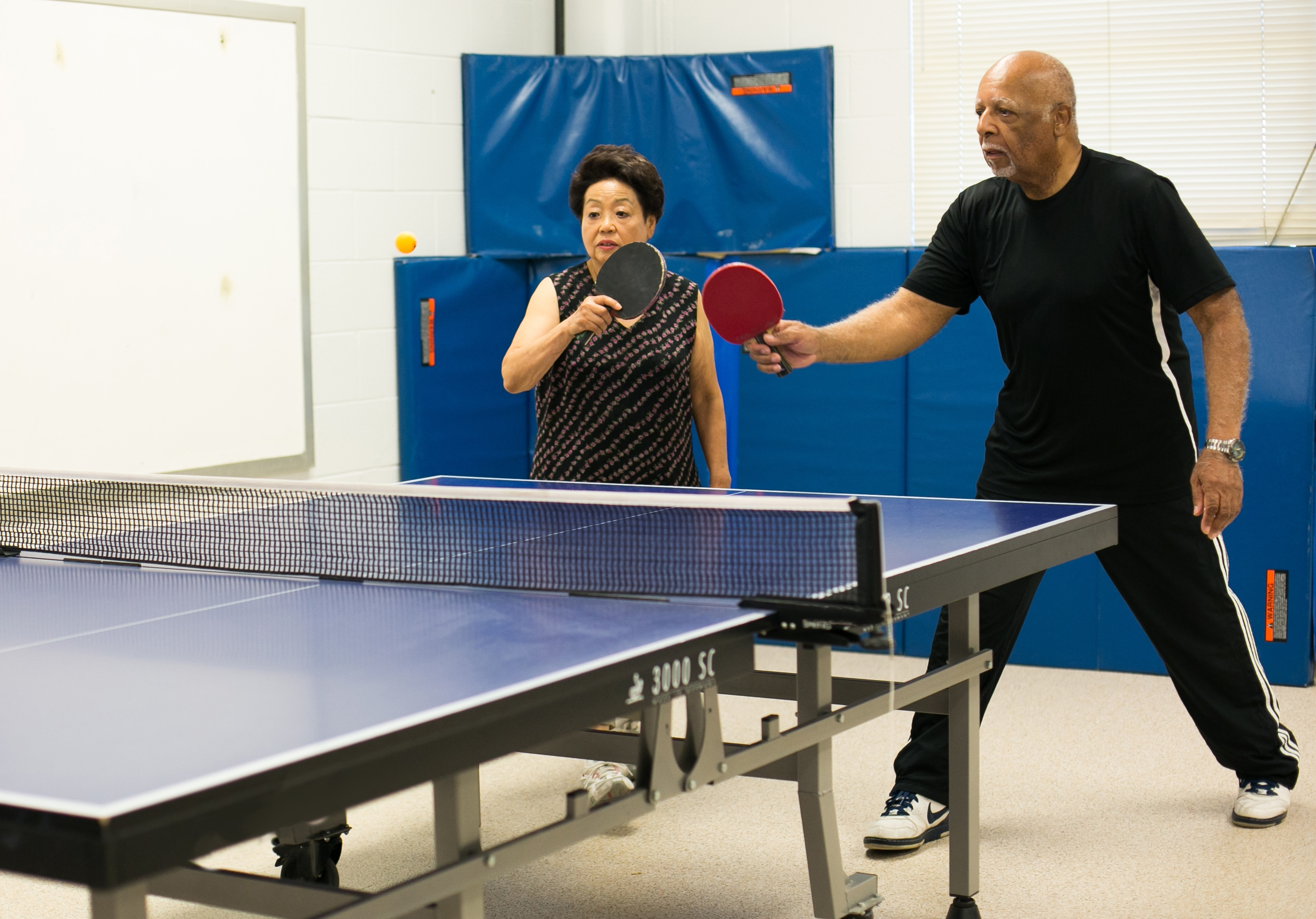 Two people playing Ping Pong