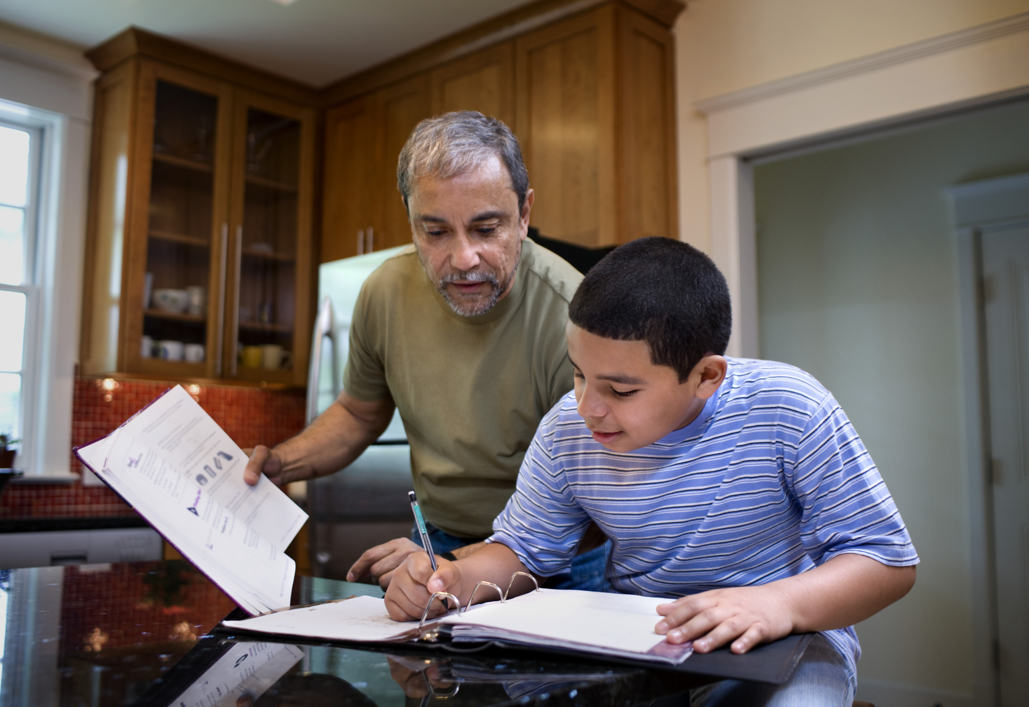 Mentor helping a kid with homework