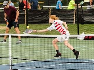 Kid playing pickleball